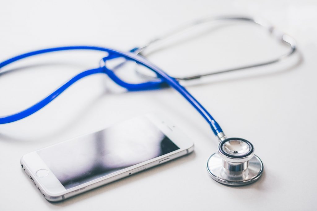 A stethoscope next to a mobile phone