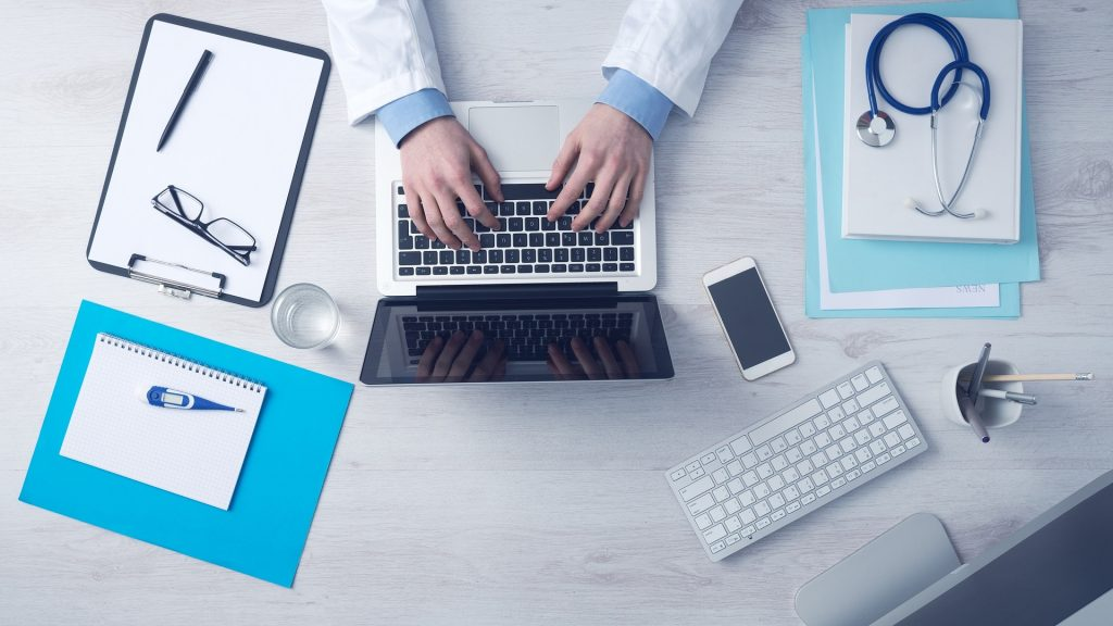 A mobile doctor preparing for an online consultation
