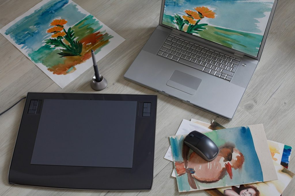 A graphics tablet and laptop used for online art classes