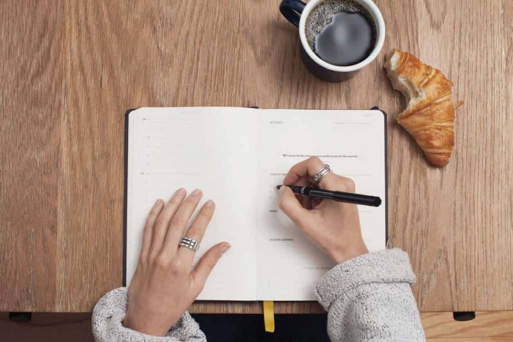 working from home - a person creating a to-do list